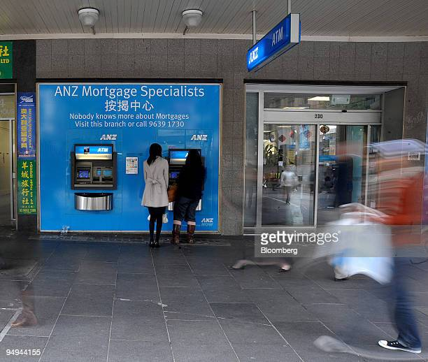 Customers use an automated teller machine at a branch of Australia New Zealand Banking Group Ltd in Melbourne Australia on Wednesday April 29 2009...