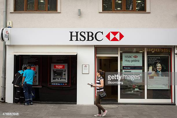 Customers use an automated teller machine outside an HSBC Holdings Plc bank branch in the Besiktas district of Istanbul, Turkey, on Thursday, June...