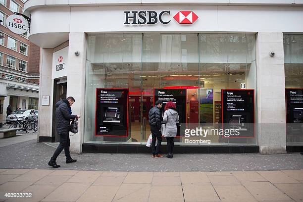 Customers use an HSBC automated teller machine outside a bank branch, operated by HSBC Holdings Plc, in London, U.K., on Thursday, Feb. 19, 2015 HSBC...
