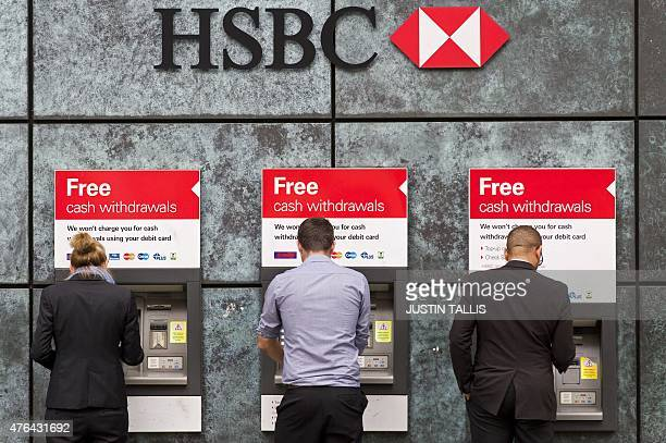 Customers use ATM cashpoints outside a HSBC bank branch in London on June 9 2015 Scandalhit bank HSBC said it would cut its global headcount by up to...