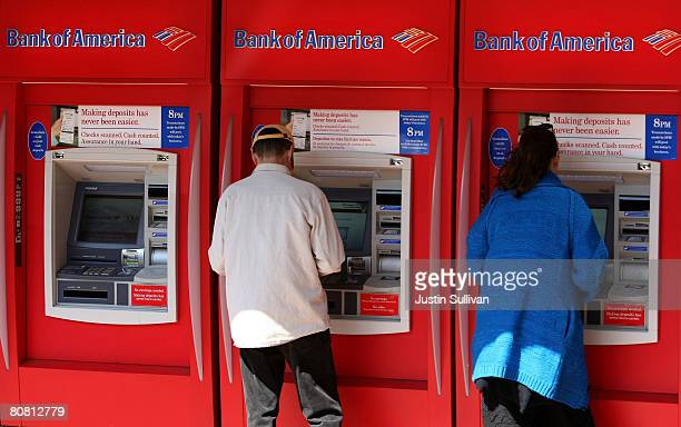 Customers use ATM machines at a Bank of America branch office April 21 2008 in San Francisco California Bank of America the nation's largest retail...