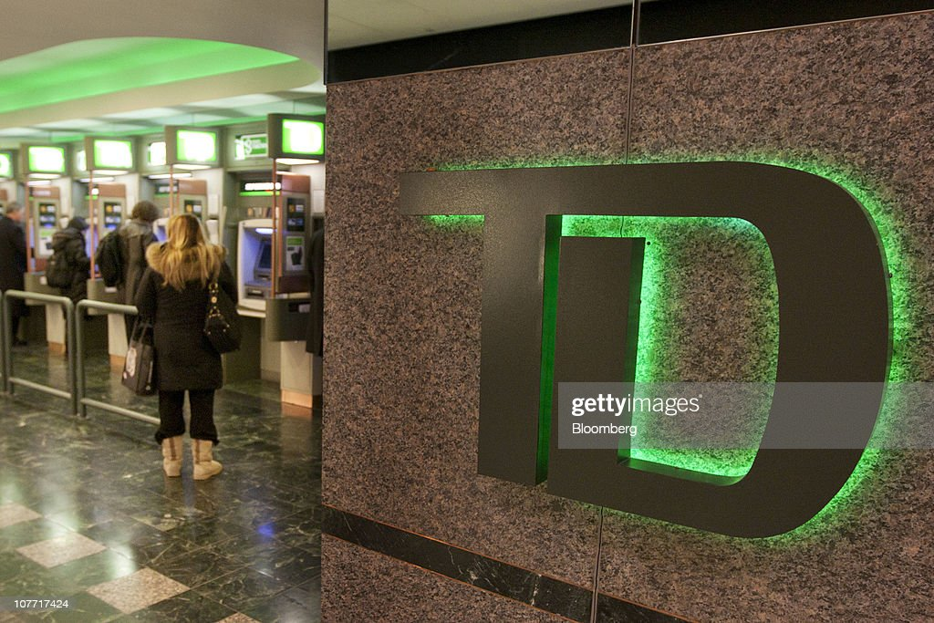 Customers use ATM machines at one of Toronto-Dominion Bank's (TD) Canada Trust branches in Toronto, Ontario, Canada, on Tuesday, Dec. 21, 2010. Toronto-Dominion Bank agreed to buy Chrysler Financial Corp. from Cerberus Capital Management LP for $6.3 billion in cash, adding an auto-finance company in its second-largest acquisition. Photographer: Norm Betts/Bloomberg via Getty Images