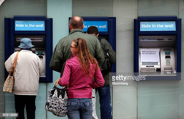Customers use ATM machines outside a branch of Barclays bank in London UK on Monday Nov 9 2009 Governments spent more than $500 billion in the past...