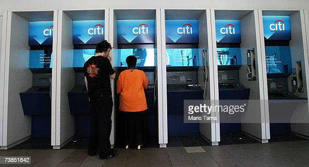 Customers use ATMs inside a Citibank branch April 10 2007 in New York City Citigroup is reportedly expected to announce a major overhaul of its...