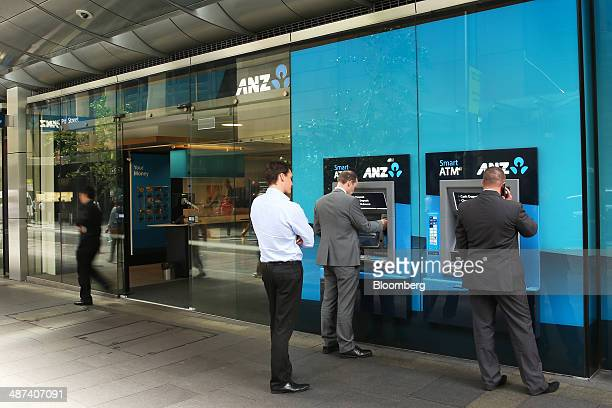 Customers use Australia New Zealand Banking Group Ltd automated teller machines in Sydney Australia on Wednesday April 30 2014 ANZ the quickest...