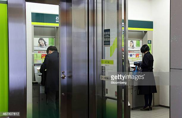 Customers use automated teller machines at a Sumitomo Mitsui Banking Corp branch in Tokyo Japan on Monday Jan 26 2015 Sumitomo Mitsui Financial Group...