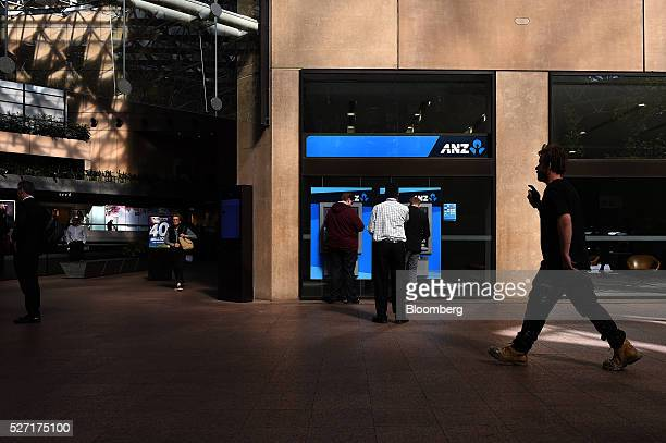Customers use automated teller machines at an Australia New Zealand Banking Group Ltd branch in Melbourne Australia on Monday May 2 2016 ANZ is...