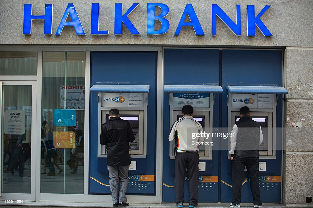 Customers use automated teller machines (ATM) in Turkiye Halk Bankasi AS, also known as Halkbank, in Istanbul, Turkey, on Thursday, April 4, 2013. Turkey's gross domestic product expanded 2.2 percent in 2012, down from 8.8 percent the previous year, according to data released by the statistics office in Ankara on April 1. Photographer: Kerem Uzel/Bloomberg via Getty Images