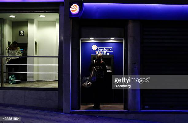 Customers use automated teller machines operated by Alpha Bank AE left and Eurobank Ergasias SA in Athens Greece on Tuesday Nov 3 2015 Greece's four...