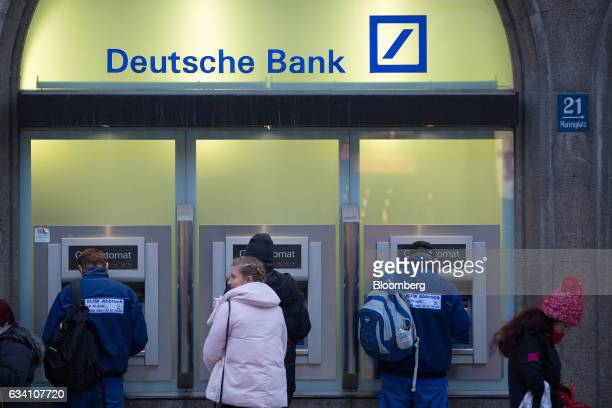 Customers use automated teller machines outside a Deutsche Bank AG bank branch in Munich Germany on Monday Feb 6 2017 Even with consumerprice growth...