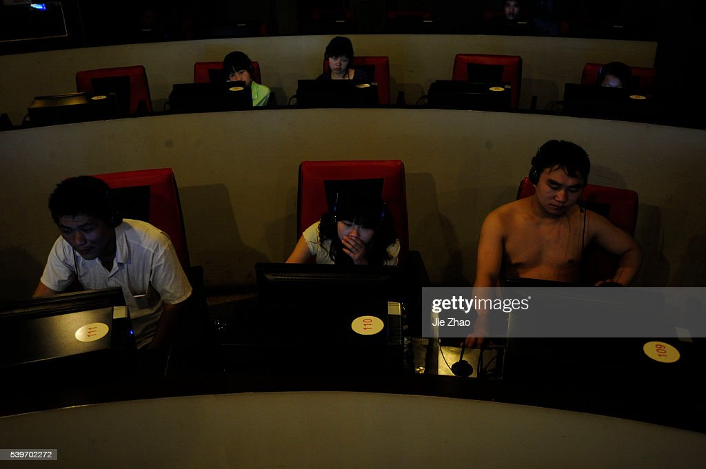 Customers use computers at an internet cafe in Hefei, Anhui province : News Photo