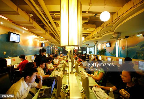 Customers use computers at an internet cafe in Shanghai China on Saturday Nov 15 2008 As Chinese citizens increasingly use the Internet to get news...