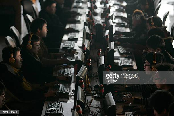 Customers use computers at an internet cafe in Taiyuan Shanxi province January 25 2010 China widened its attack against US criticisms of Internet...