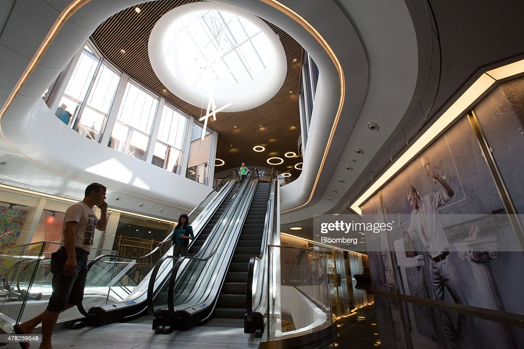 Customers use escalators to move between shopping floors at the Esentai luxury shopping mall in Almaty, Kazakhstan, on Tuesday, June 23, 2015. Kazakhstan completed its negotiations to become the 162nd member of the World Trade Organization, after 19 years of negotiations, and hopes to fully ratify its accession by Oct. 31. Photographer: Andrey Rudakov/Bloomberg via Getty Images