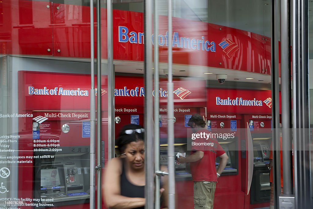 Customers use the ATMs at a Bank of America Corp. branch in New York, U.S., on Wednesday, July 18, 2012. Bank of America Corp., the second- biggest U.S. lender, plans to trim $3 billion in annual expenses from investment banking, trading and wealth-management units. Photographer: Scott Eells/Bloomberg via Getty Images