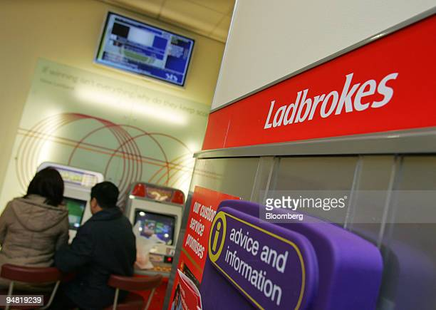 Customers use the electronic betting machines, Thursday, December 22 at a Ladbrokes in London. Blackstone Group LP, CVC Capital Partners Ltd. And BC...
