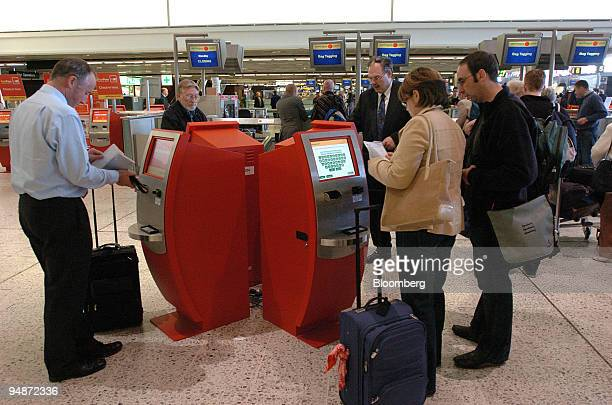 Customers use the new Aer Lingus auto checkin machines at Dublin Airport Tuesday October 5 2004