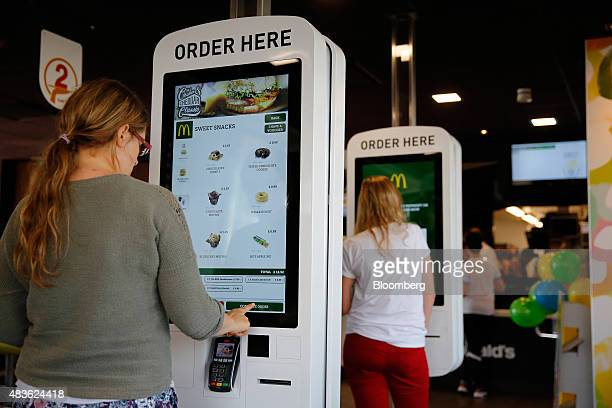 Customers use touch screen panels to order food inside a McDonald's Corp restaurant in Manchester UK on Monday Aug 10 2015 McDonald's Chief Executive...