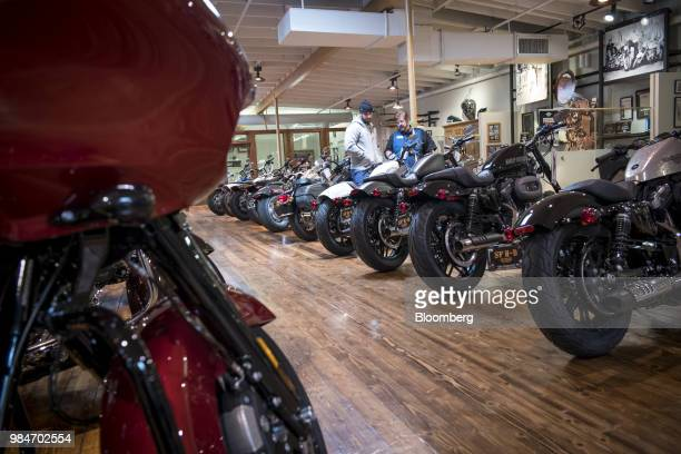 Customers view HarleyDavidson Inc motorcycles at the company's dealership in South San Francisco California US on Tuesday June 26 2018 President...
