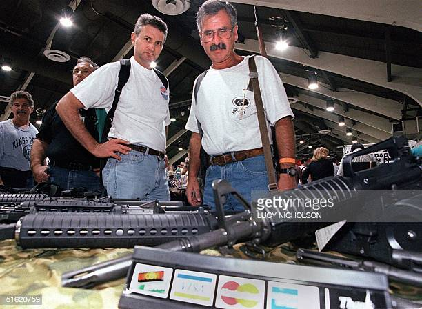 Customers view semi-automatic weapons for sale at the 31st Annual Great Western gun show in Pomona 29 October 1999. It may be the last time the...