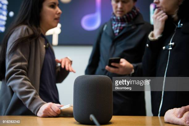 Customers view the HomePod speaker on the first day of sales at an Apple Inc store in New York US on Friday Feb 9 2018 Apple Inc's...