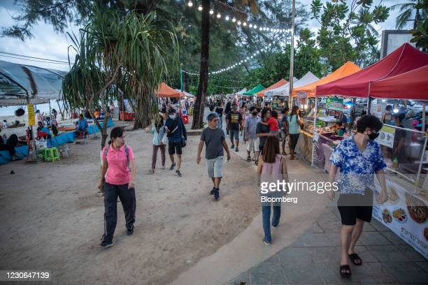 Customers visit a market in Patong, Phuket, Thailand, on Saturday, Dec. 19, 2020. The tepid response to Thailands highly publicized reopening...