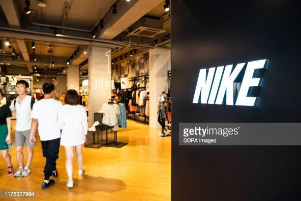 Customers visit American multinational sportswear manufacturer Nike store in Shenzhen.