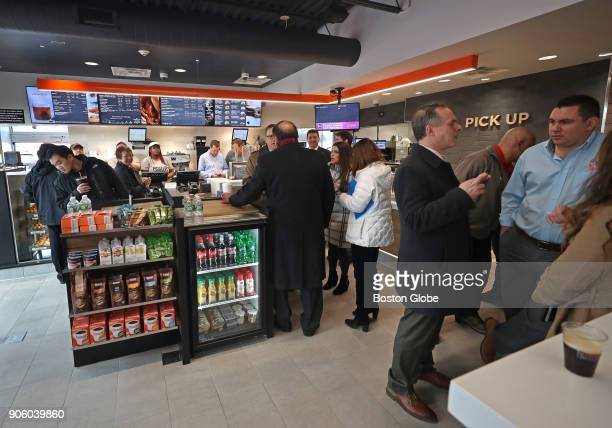 Customers visit the new Dunkin' store in Quincy MA on Jan 16 2018 The famed local chain debuted the new store with Donuts removed from its name...