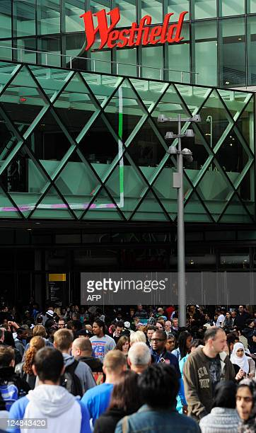 Customers visit the Westfield Stratford City shopping centre in east London on September 13 2011 Europe's biggest urban shopping centre opened on...