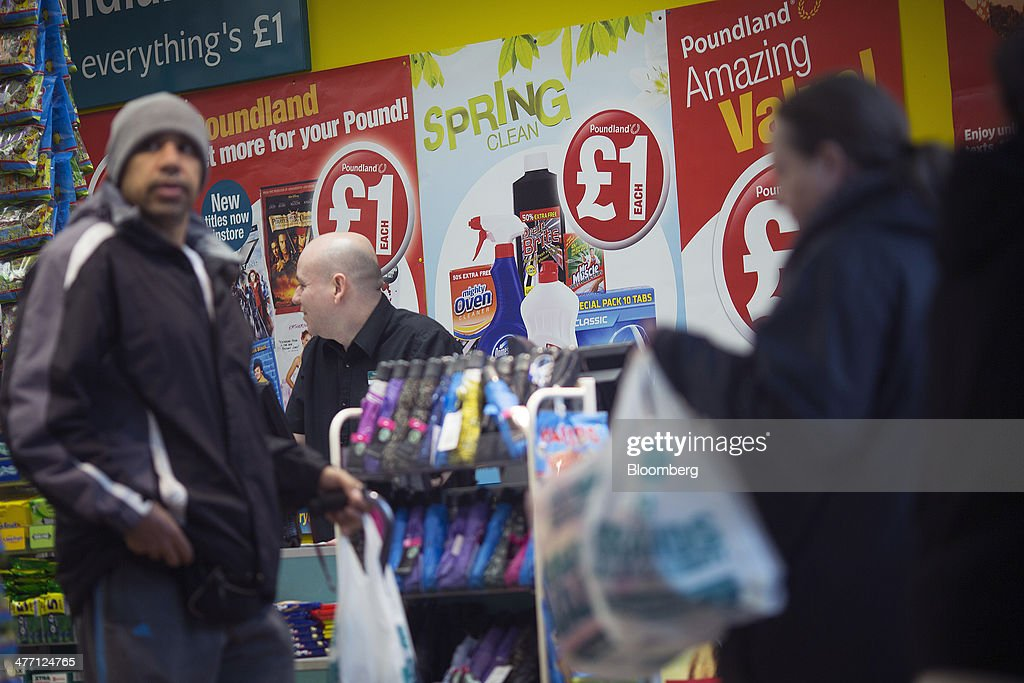 Customers wait at a check-out desk inside a Poundland discount store, operated by Poundland Group Plc in London, U.K., on Friday, March 7, 2014. Poundland Group Plc has demand for all the shares it is selling in an initial public offering that will value the U.K. discount retailer at as much as 750 million pounds ($1.3 billion), according to terms of the deal. Photographer: Simon Dawson/Bloomberg via Getty Images