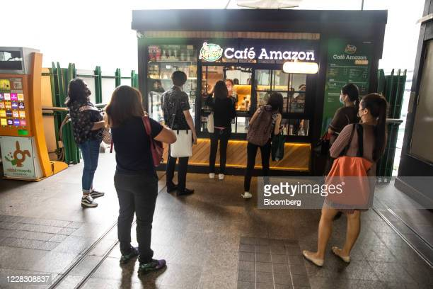 Customers wait for their orders at a Cafe Amazon outlet in Bangkok Thailand on Wednesday Sept 2 2020 Thailand has reported zero locallytransmitted...