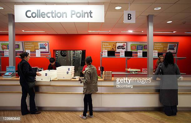 Customers wait for their orders at the collection point inside an Argos store operated by Home Retail Group Plc in Enfield UK on Wednesday Sept 7...