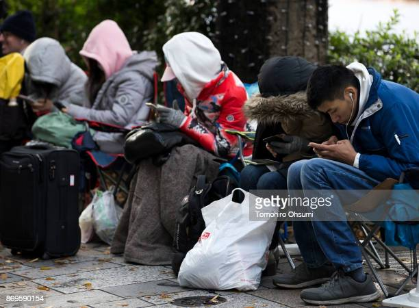 Customers wait in line before the launch of the iPhone X outside the Apple Omotesando store on November 3 2017 in Tokyo Japan Apple launched the...