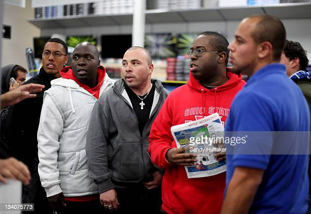 Customers wait in line for electronics items during 'Black Friday' at a Best Buy store on November 25 2011 San Diego California Thousands of...