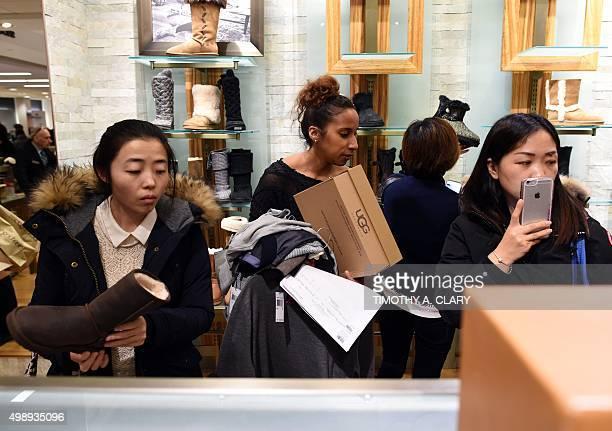 Customers wait in line in the woman's shoe department during the Black Friday sale at Bloomingdale's at 59th Street and Lexington Avenue in New York...