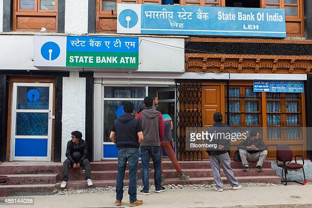 Customers wait in line outside a State Bank of India in Leh Jammu and Kashmir India on Wednesday Aug 5 2015 India is scheduled to release...