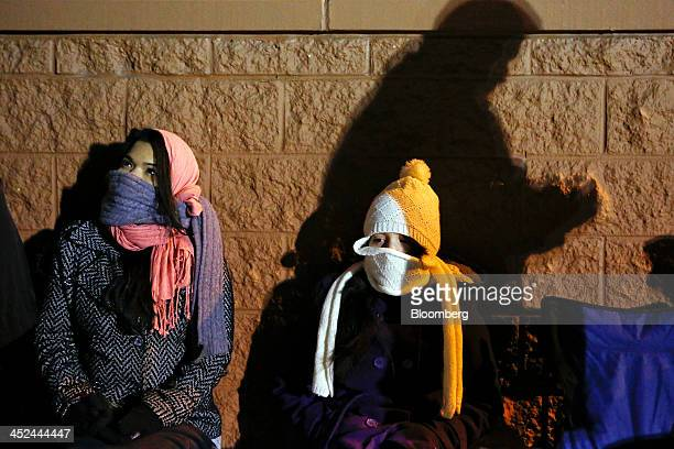 Customers wait in line outside a Target Corp store ahead of Black Friday in Chicago Illinois US on Thursday Nov 28 2013 US retailers will kick off...
