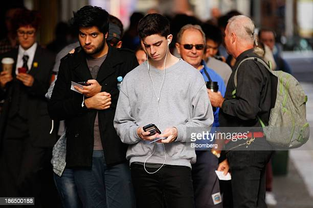 Customers wait in line outside Apple's Inc's George Street store ahead of the launch of the company's iPad Air in Sydney Australia on Friday Nov 1...