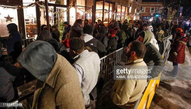 Customers wait in line outside Sunnyside Cannabis Dispensary to purchase recreational marijuana on January 1 2020 in Chicago Illinois On the first...