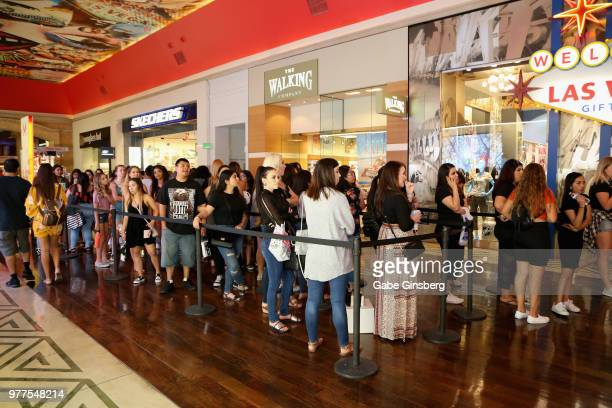 Customers wait in line to attend the Morphe store opening at the Miracle Mile Shops at Planet Hollywood Resort Casino on June 16 2018 in Las Vegas...