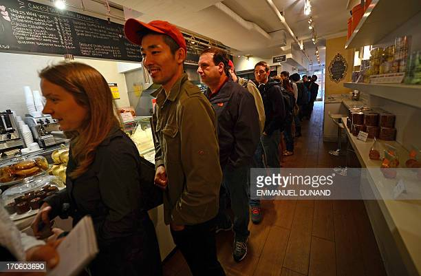 Customers wait in line to buy cronuts a croissantdoughnut hybrid the brain child of French pastry chef Dominique Ansel at Ansel's bakery shop in New...
