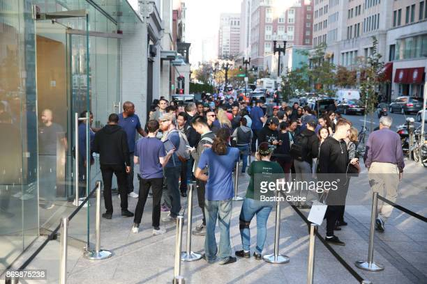 Customers wait in line to buy the new iPhone X on release day outside the Boylston Street Apple Store in Boston on Nov 3 2017
