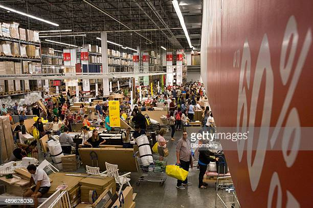 Customers wait in line to checkout at an Ikea store in the Brooklyn borough of New York US on Saturday Sept 19 2015 The US Census Bureau is scheduled...