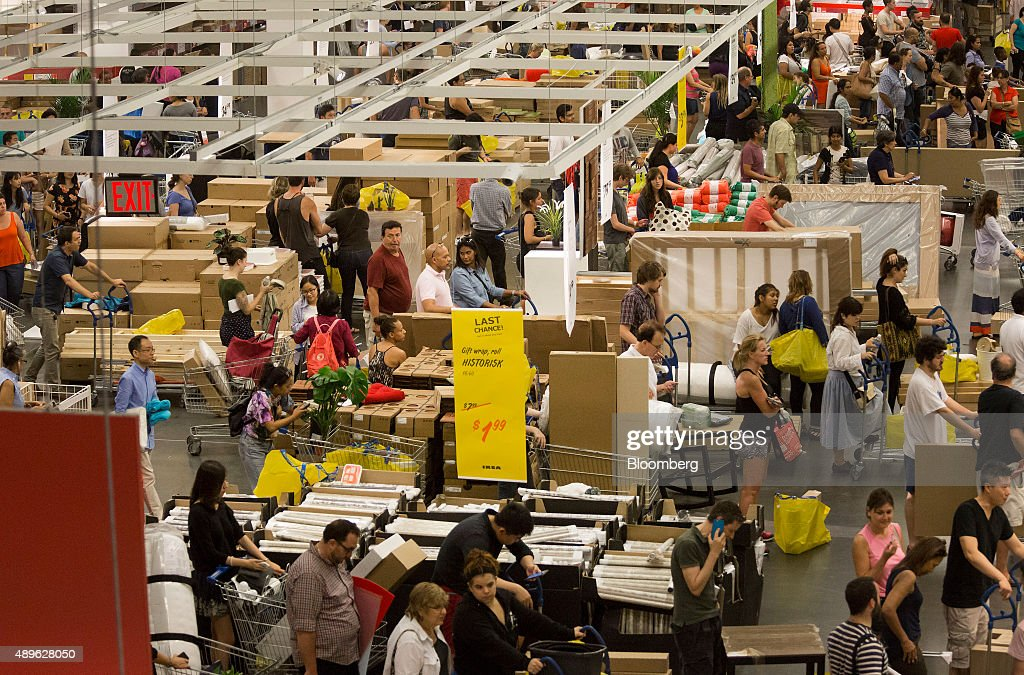 Customers wait in line to checkout at an Ikea store in the Brooklyn borough of New York, U.S., on Saturday, Sept. 19, 2015. The U.S. Census Bureau is scheduled to release monthly durable goods data on Sept. 24. Photographer: Michael Nagle/Bloomberg via Getty Images