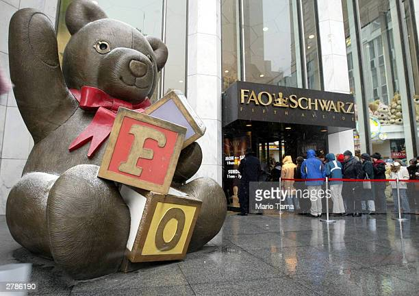 Customers wait in line to enter FAO Schwarz December 5 2003 in New York City The owner of FAO Schwarz toy stores stated that the company will file...