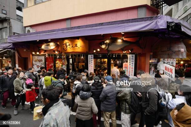 Customers wait in line to enter Sushi Zanmai restaurant in Tokyo Japan on Friday Jan 5 2018 Kiyomura KK operator of Sushi Zanmai restaurant made this...