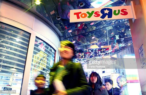 Customers wait in line to enter Toys R Us in Times Square on Thanksgiving evening for early Black Friday sales on November 26 2015 in New York City...