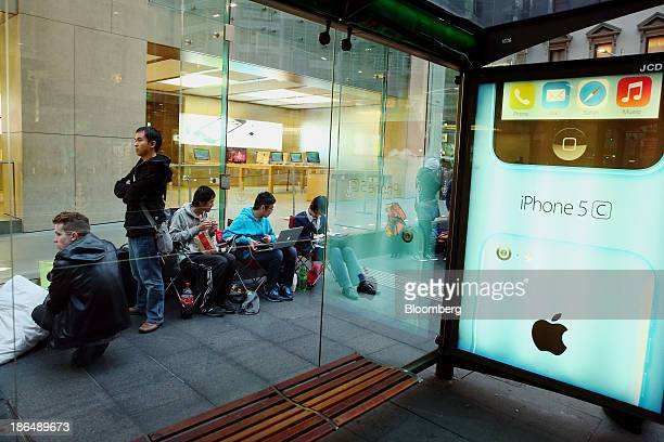 Customers wait in line to purchase outside Apple's Inc's the George Street store ahead of the launch of the companys iPad Air in Sydney Australia on...