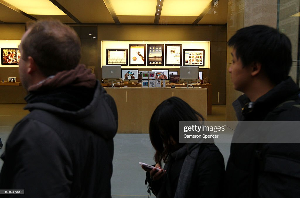 Customers wait in line to purchase the iPad outside the Apple store on George Street on May 28, 2010 in Sydney, Australia. Apple's new tablet media device went on sale in nine countries around the world today following its launch in the United States in April this year.