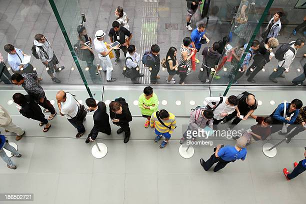Customers wait in line to purchase the new Apple Inc iPad Air at the company's George Street store in Sydney Australia on Friday Nov 1 2013 Apple...